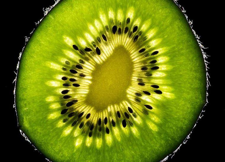 Here's why eating a Kiwi before bed can help you sleep. Half a cut open Kiwi