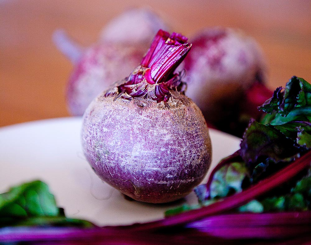 The health benefits of eating beetroot. A raw beetroot sits on a table top
