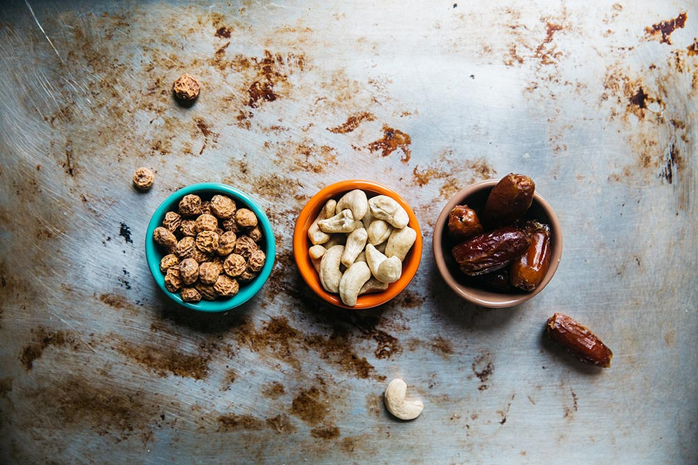 Top ten foods from each category that burn fat and build muscle. Nuts in bowls on a table top