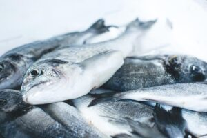 Creatine comes naturally in these foods. Lots of fish piled up on a kitchen side