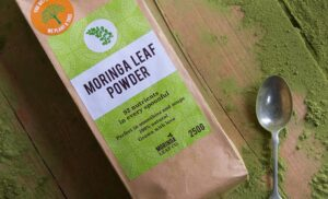 The benefits of taking Moringa the miracle tree. A bag of powdered Moringa on a table