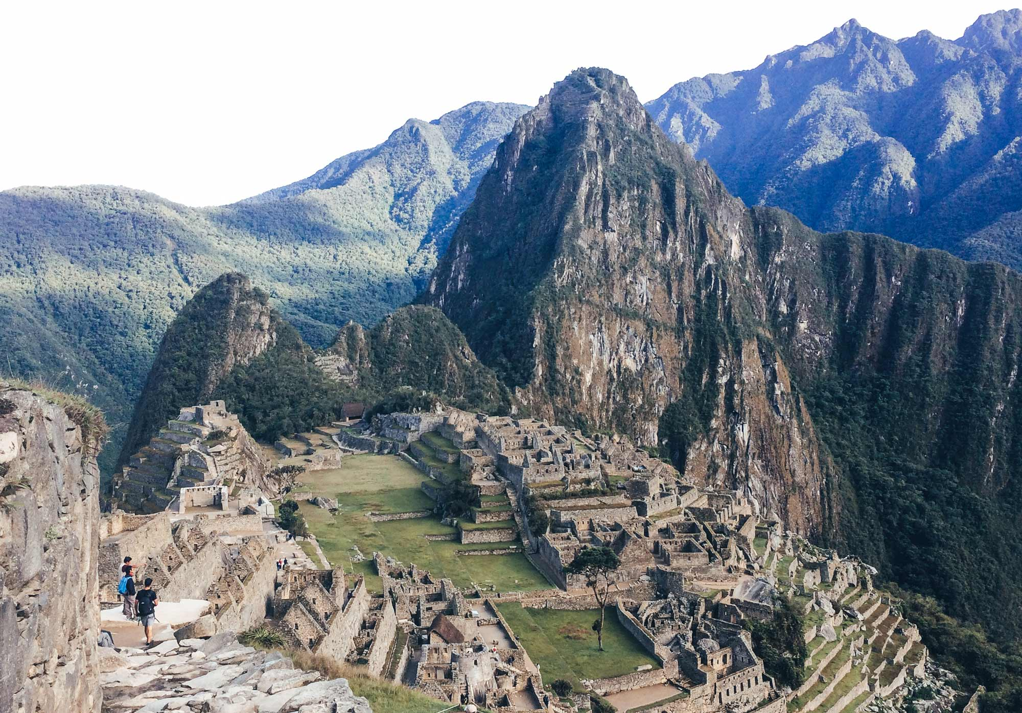 Trekking the Inca Trail to Machu Pichu. The view looking down onto the Incan city of Machu Pichu from the Sun Gate with the andes mountains behind