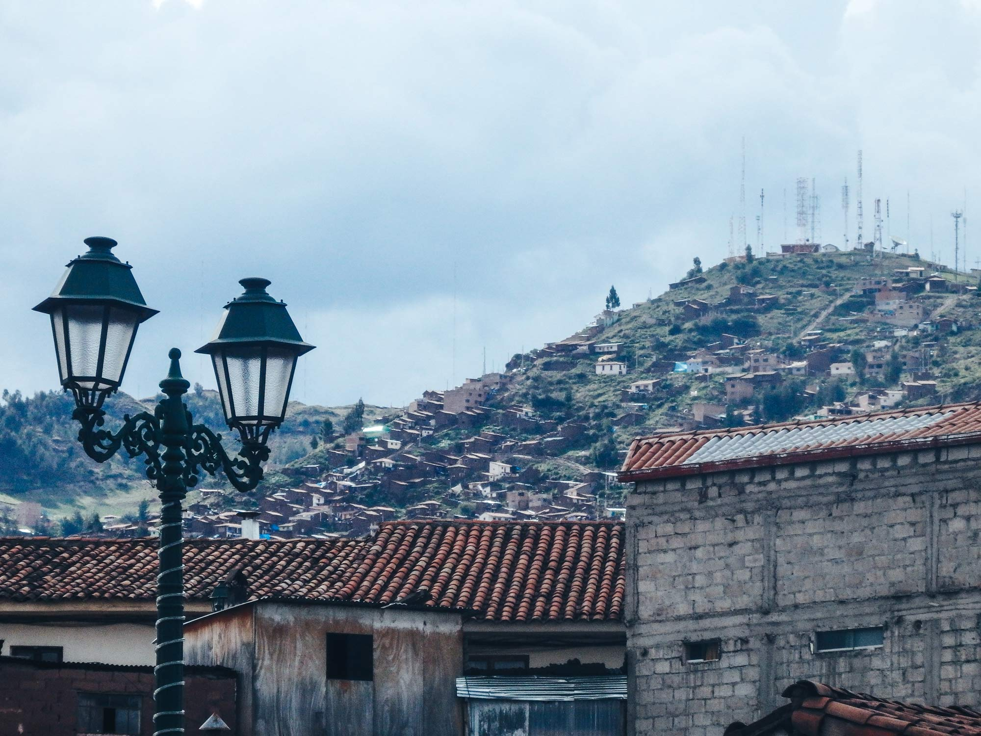 Why travelling Cusco is epic! Looking onto the surrounding city of Cusco in the hills of The Andes