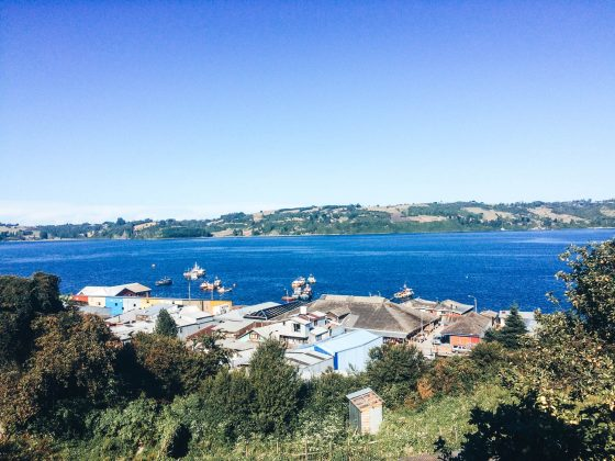 Here's the best way to backpack Chiloé Island. A view looking out over the water with one of the small towns below