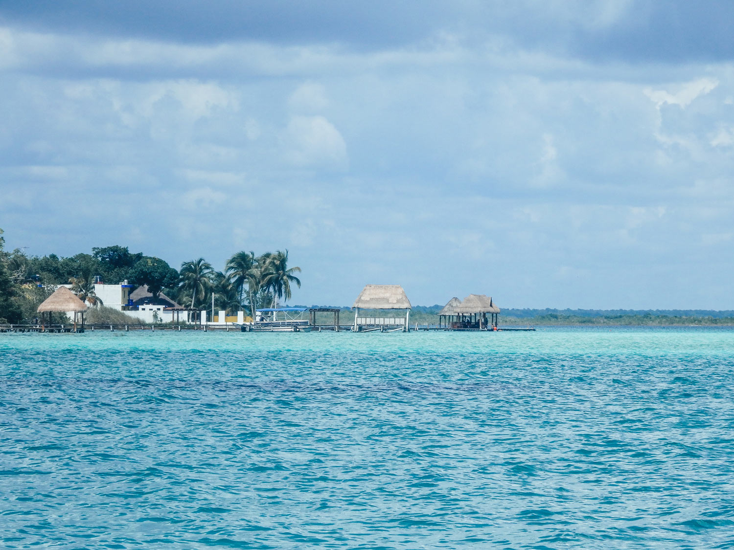 Travelling Caye Caulker the tropical paradise. A view of the wooden peers sticking out from the island