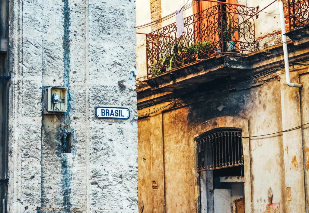 Here's why you'll feel at home backpacking Havana. A street sign named brazil on the corner of a building