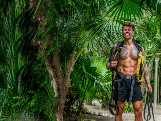 15 life lessons I have learnt from making fitness a habit. A boy stands holding a TRX
