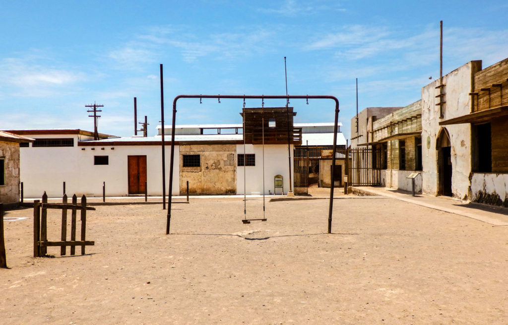All you need to know for backpacking Iquique. The abandoned mine of Humberstone with a swing in the middle