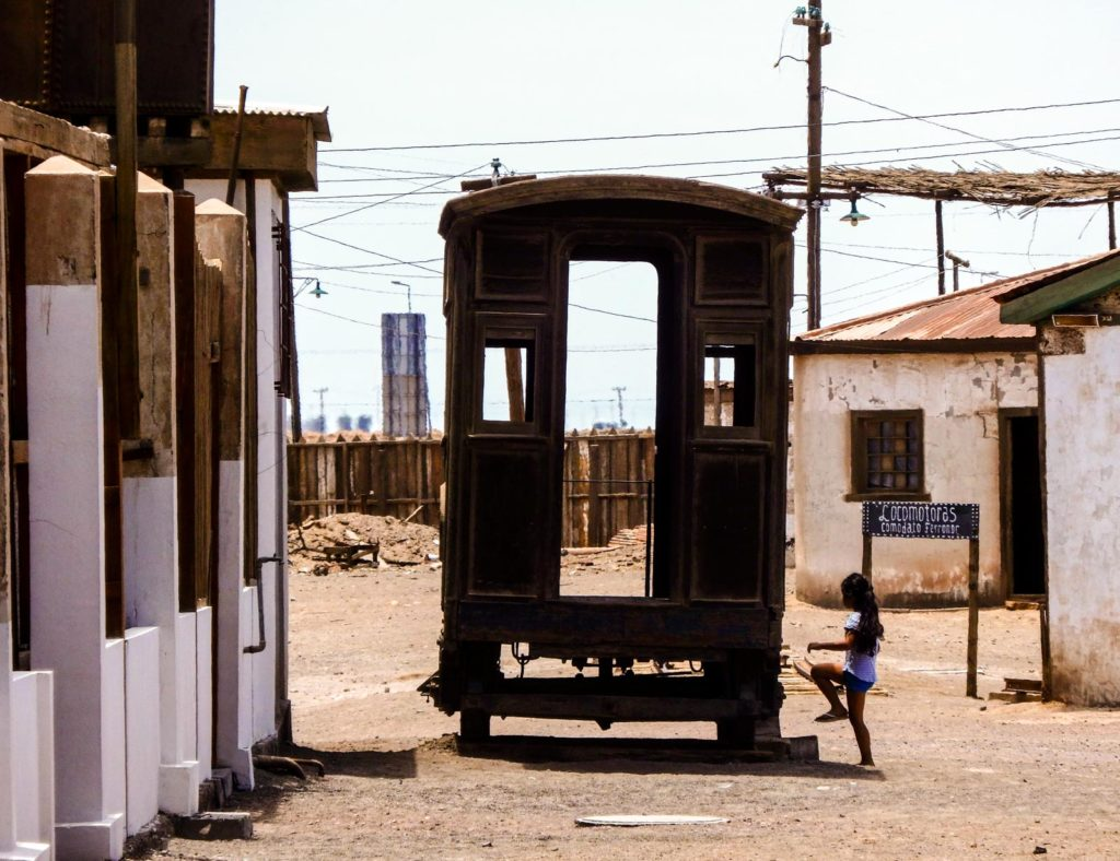All you need to know for backpacking Iquique. The abandoned mine of Humberstone a child runs onto a old railway carriage