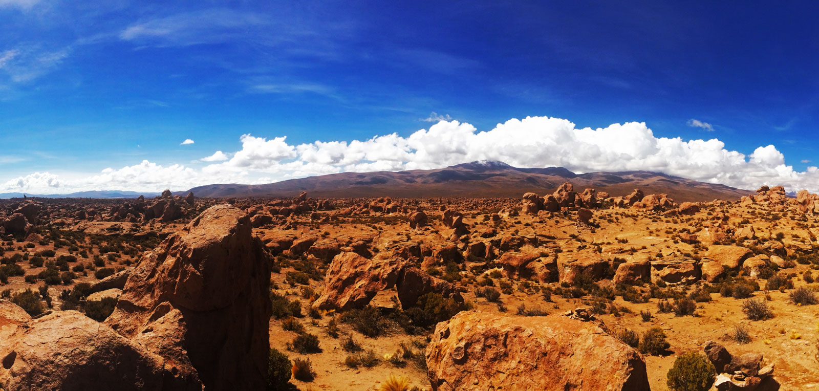 Here's the magic of backpacking San Pedro de Atacama. A view of the endless desert with rocks scattered all over