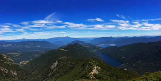 3 reasons why you CANNOT skip Pucon when travelling. The view from reaching the top of the Parque National Huerquehue trek where you can see 9 volcanoes in the 360 degree views