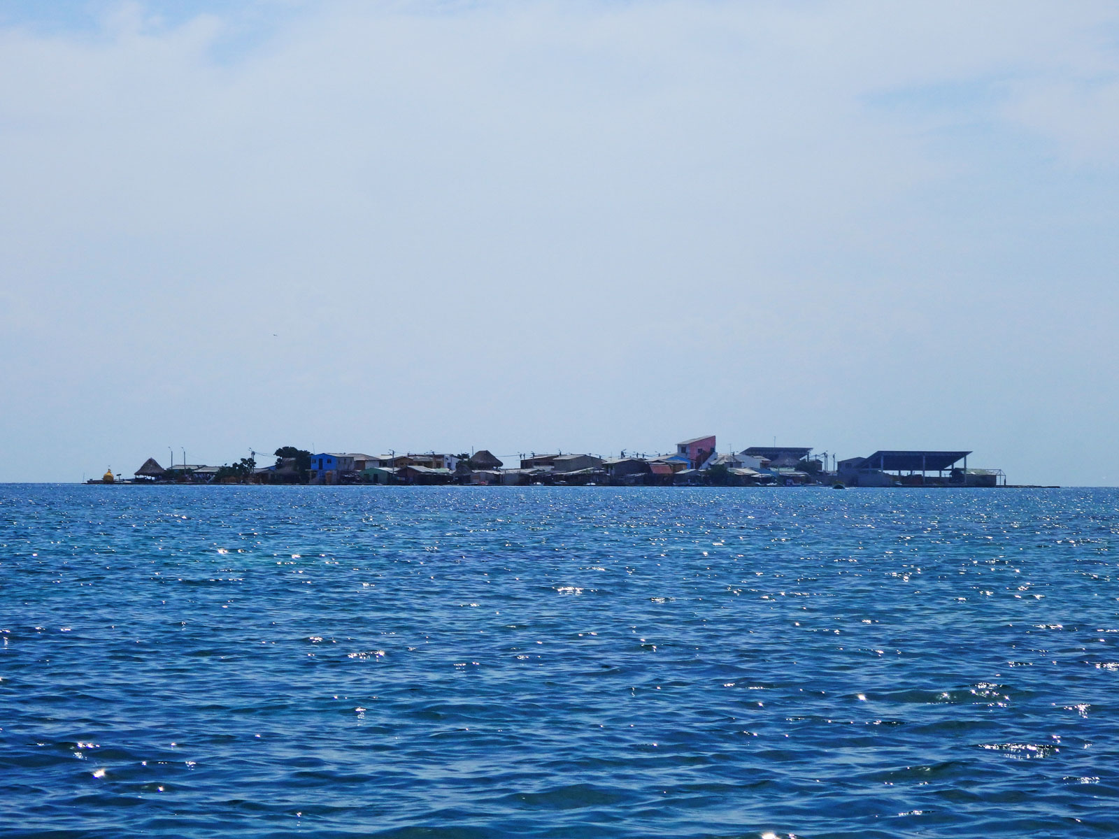 Staying at Casa en el Agua, the hostel in the sea. A view of the most densely populated island on earth Santa Cruz del Islote