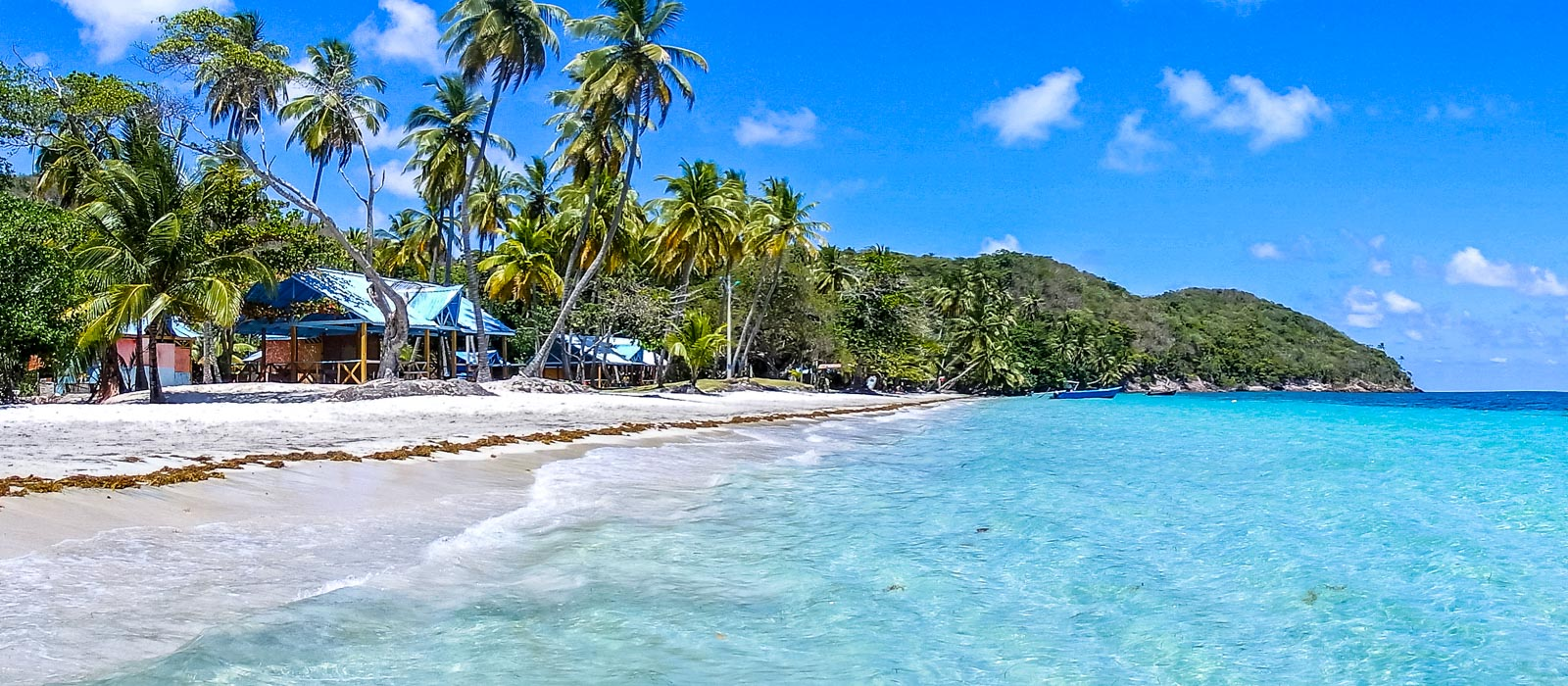 Why travelling Providencia Island shows you true paradise. The view along one of the main beaches with white golden sands and clear blue waters