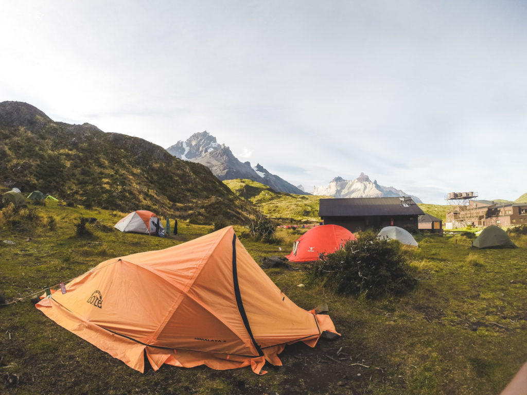 Why you should trek Torres Del Paine before you die. A tent at camp site grande with The Andes mountains in the background