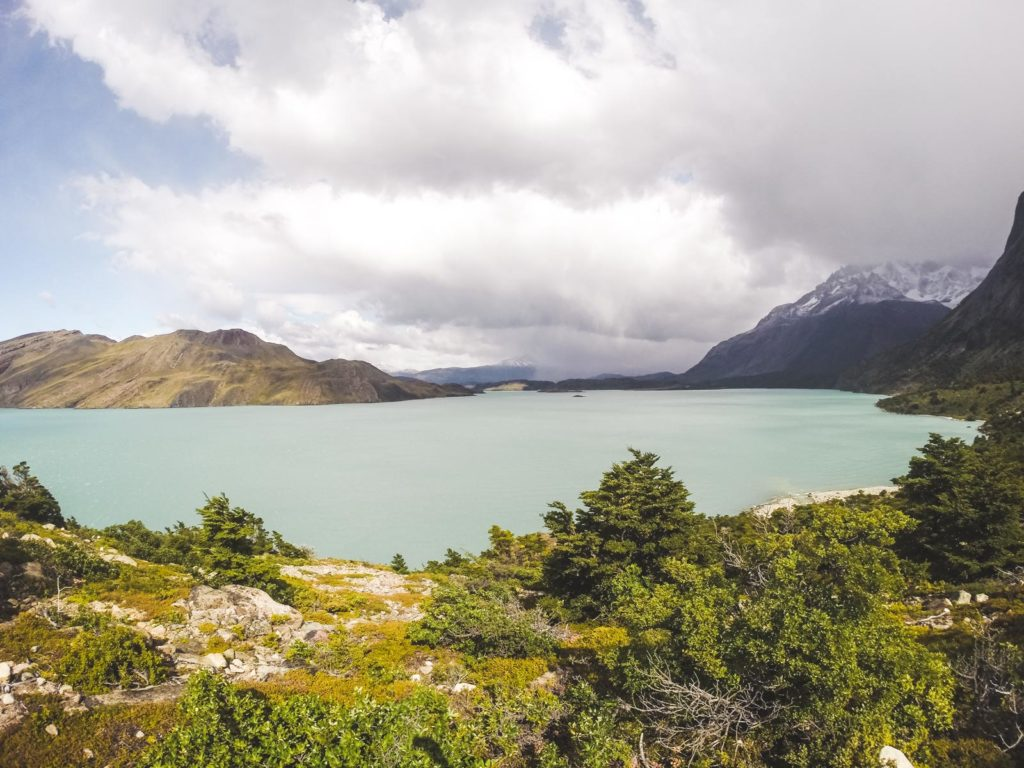 Step by step guide for planning, trekking and travelling Torres Del Paine. The view from the bottom of the W trek looking out over the blue lagoon