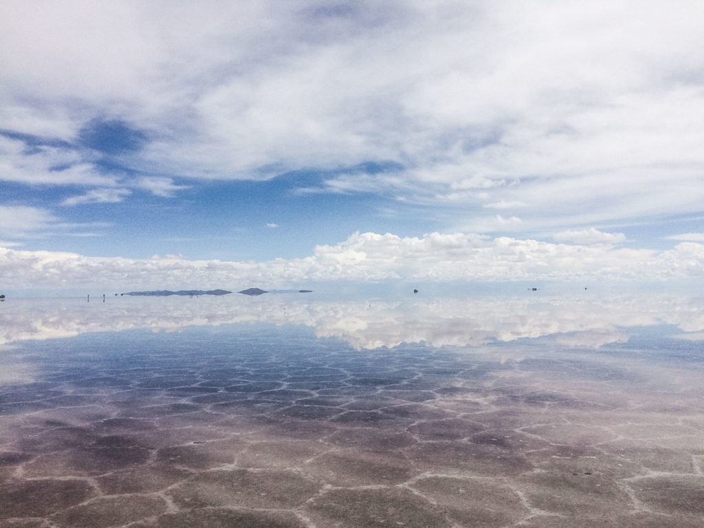 What to expect backpacking Uyuni with advice and tips. The reflection illusion created by the salt flats of the sky and clouds