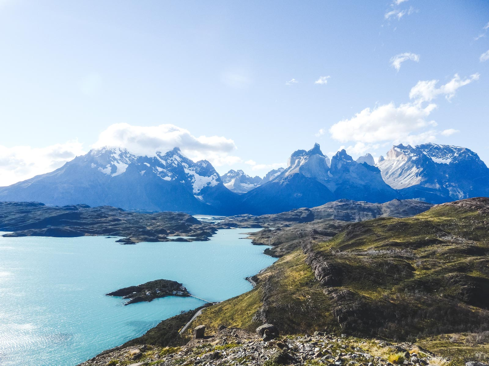 Step by step guide for planning, trekking and travelling Torres Del Paine. The view from Condor point looking out onto Torres Del Paine and lake Pehoe