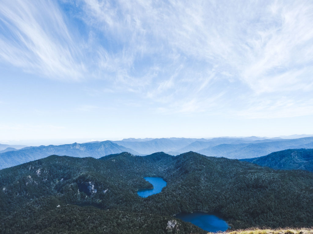 Why you cannot skip Pucon when travelling.  The view from reaching the top of the Parque National Huerquehue trek where you can see 9 volcanoes in the 360 degree views