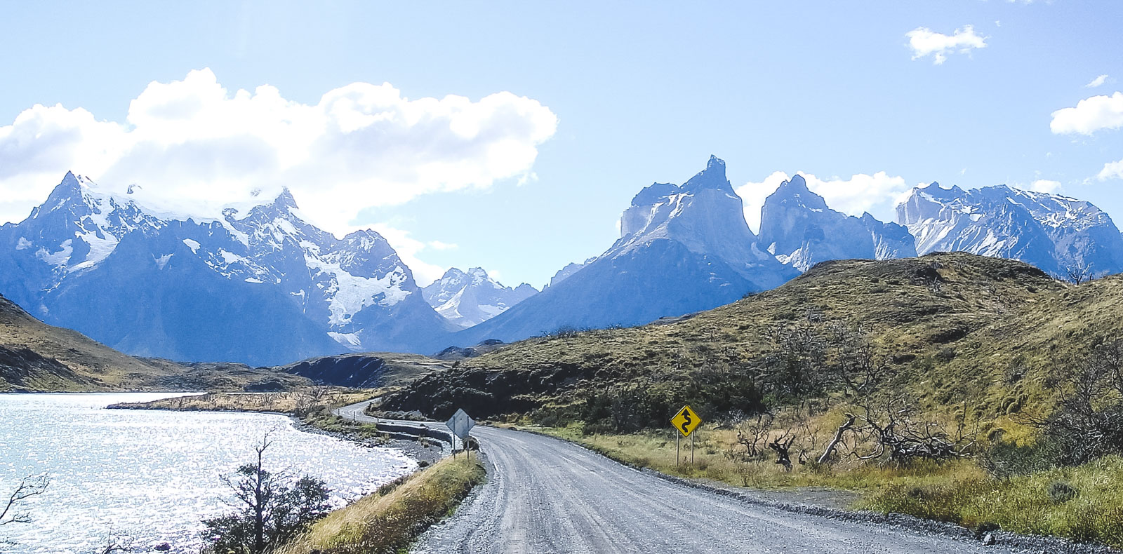 Why you should trek Torres Del Paine before you die. Walking along the road that runs alongside Torres Del Paine heading to Camp Pehoe