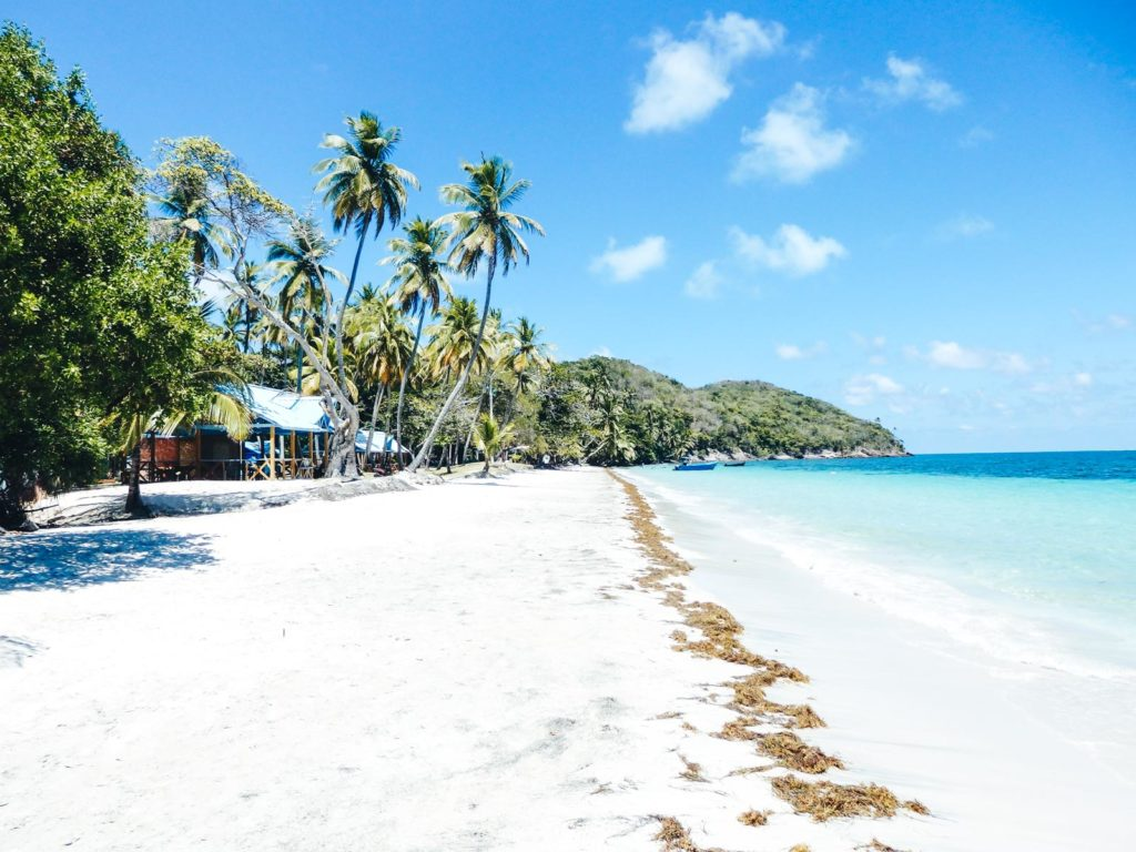 Why travelling Providencia Island shows you true paradise. One of the main beaches with it's long stretch of golden sands