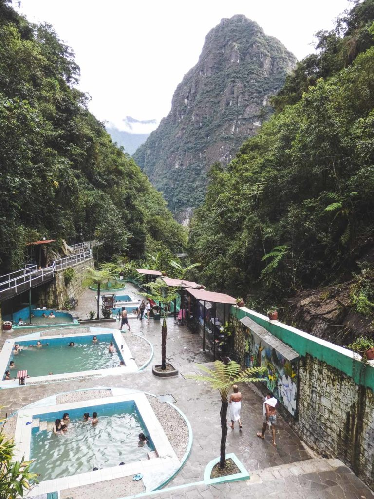 Tips for trekking the Inca Trail to Machu Pichu. Looking over the Aguascalientes thermal baths located at the top of the small hill that the town sits on