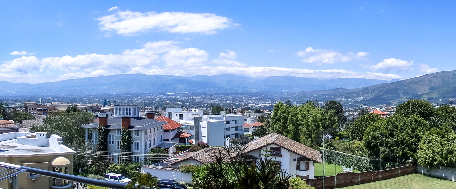 Why travelling Quito is like being with a woman. The view of Cumbaya on the other side of the valley to Quito, Mountains and lush green forest in the background