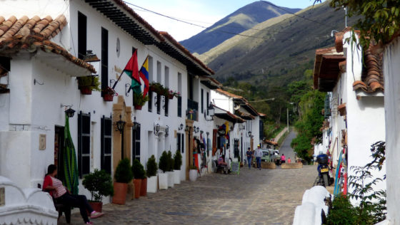 BIG and small reasons to travel Bogota. A view of the old town street with white buildings