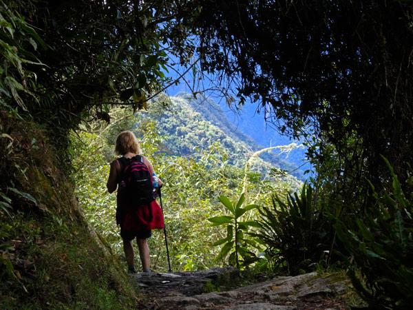 Tips for trekking the Inca Trail to Machu Pichu. A woman walking the Inca Trail