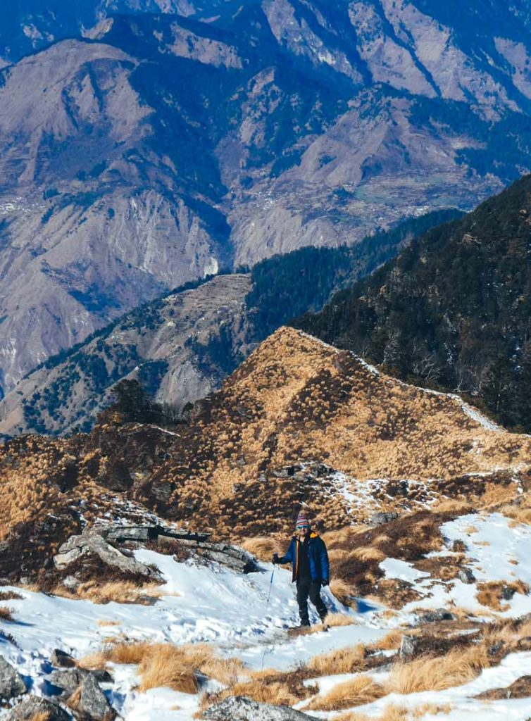 The best Himalayan travel adventure on earth: 3 day Kuari Pass Trek. A man walks along the peaks of a Himalayan mountain