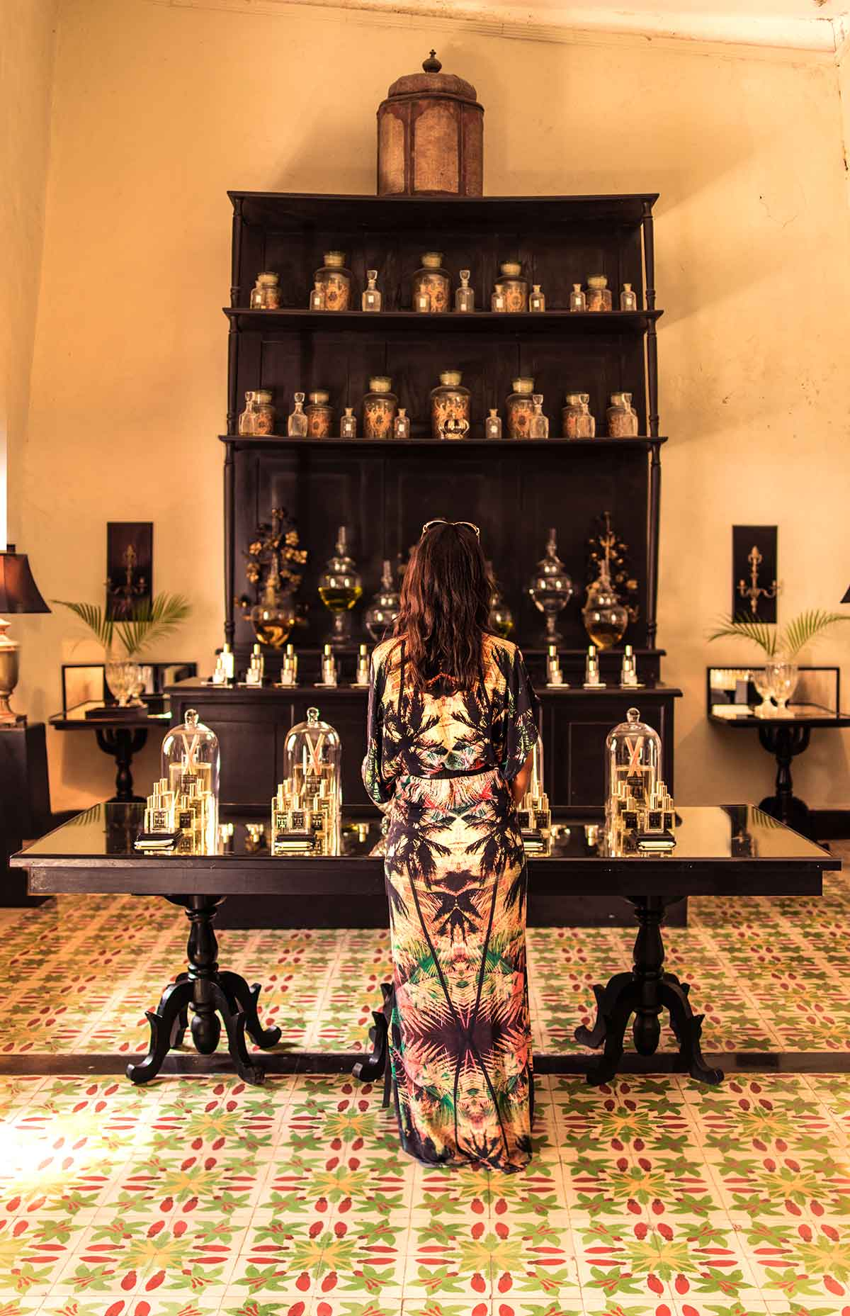 20 EPIC Valladolid Instagram spots for travelling Mexico. A woman stands with her back to camera in Coqui Coqui Perfume shop