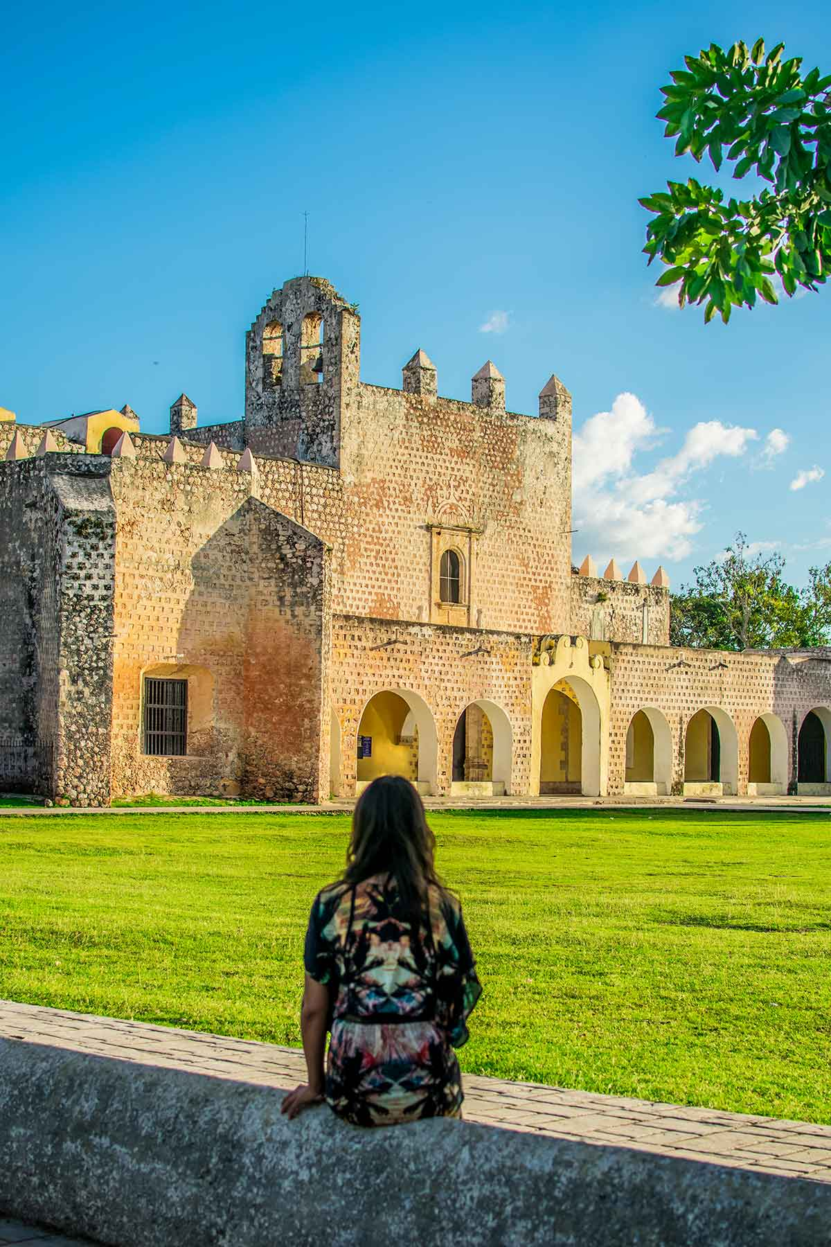 20 EPIC Valladolid Instagram spots for travelling Mexico. A woman sits in front of the Image result for Bernardino Of Siena valladolid Ex Convent of San Bernardino de Siena
