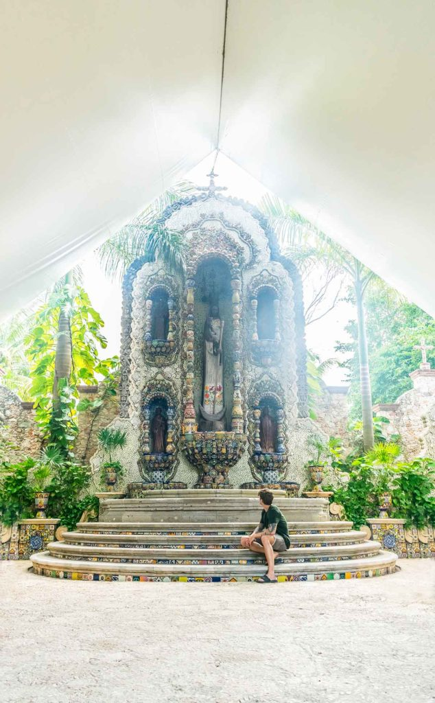 20 EPIC Valladolid Instagram spots for travelling Mexico. A woman sits in front of La Casona fountain in Valladolid built from thousands of individual tiles