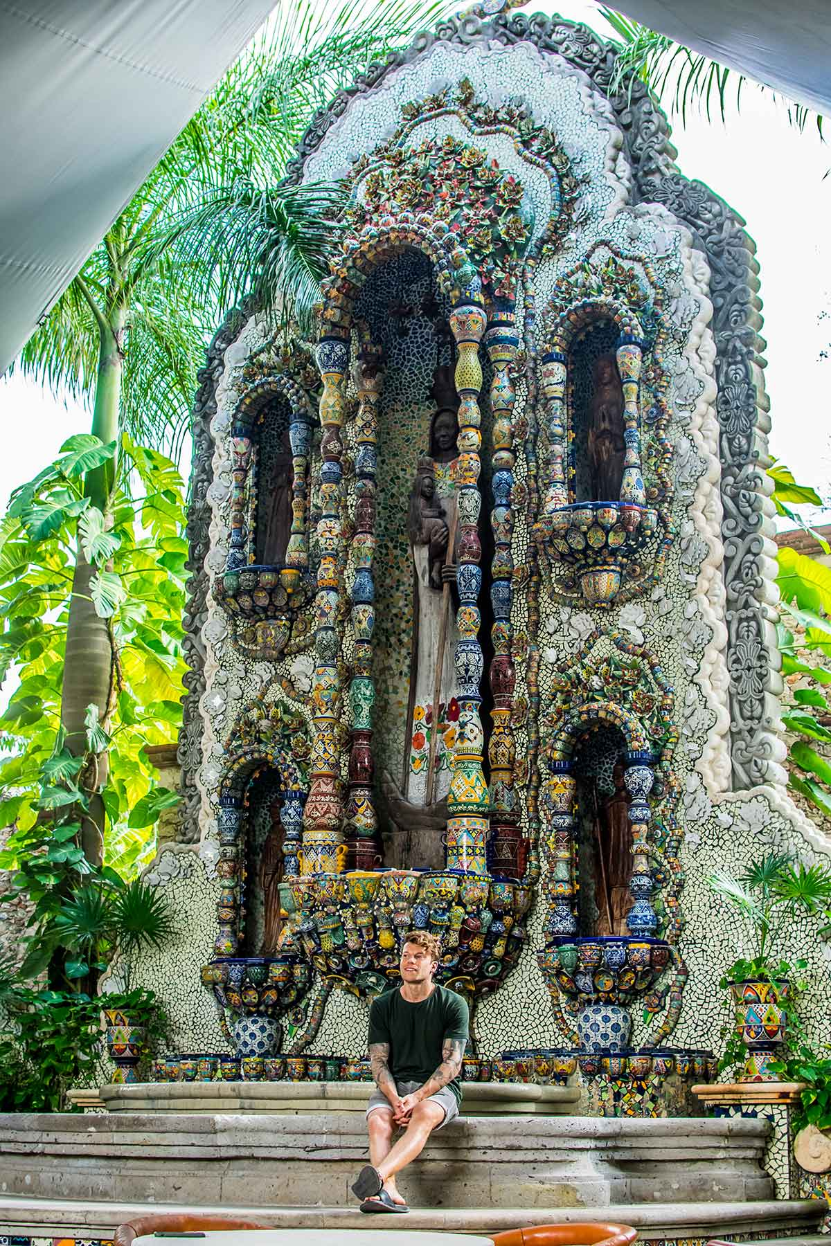 20 EPIC Valladolid Instagram spots for travelling Mexico. A man sits in front of La Casona fountain in Valladolid built from thousands of individual tiles