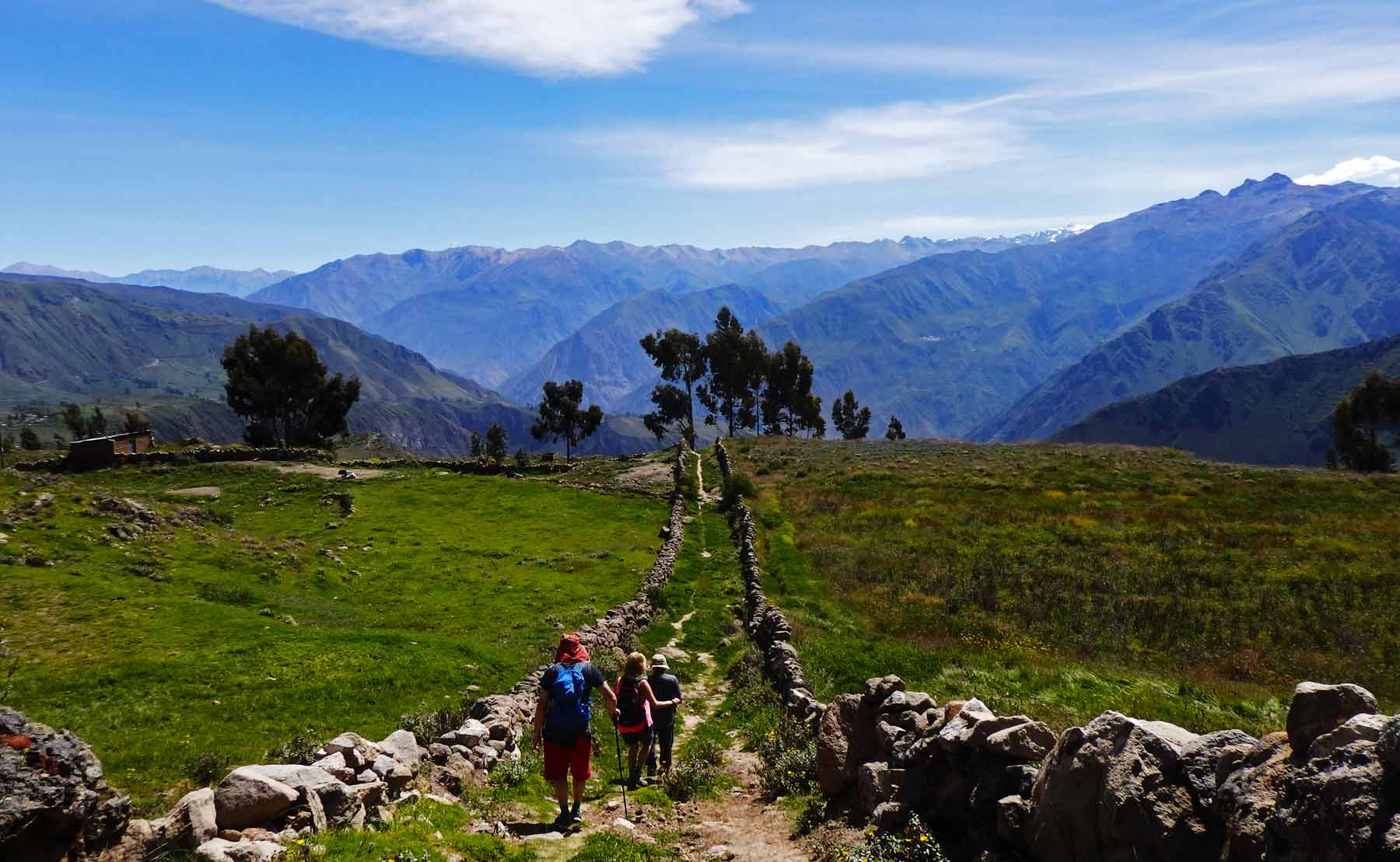 Here's why trekking Colca Canyon took my breath away. Three people walk down a country path